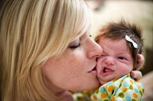 baby parenting kissing newborn