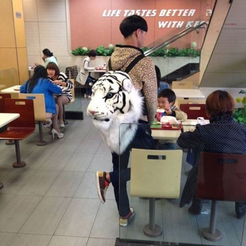 poorly dressed leopard print tiger white tiger backpack g rated - 8131249664