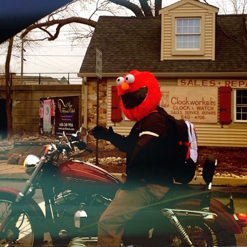 poorly dressed helmet elmo motorcycle