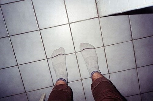 poorly dressed socks floor matching tiles
