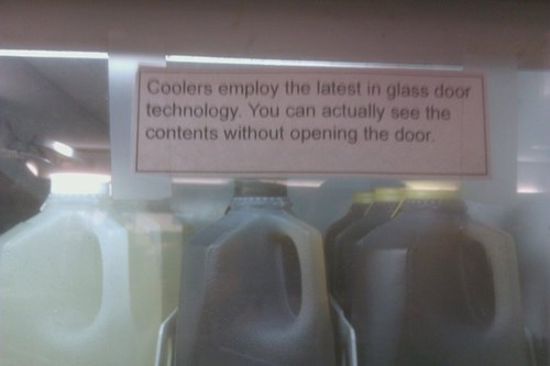 monday thru friday,cooler,sign,glass door,grocery store