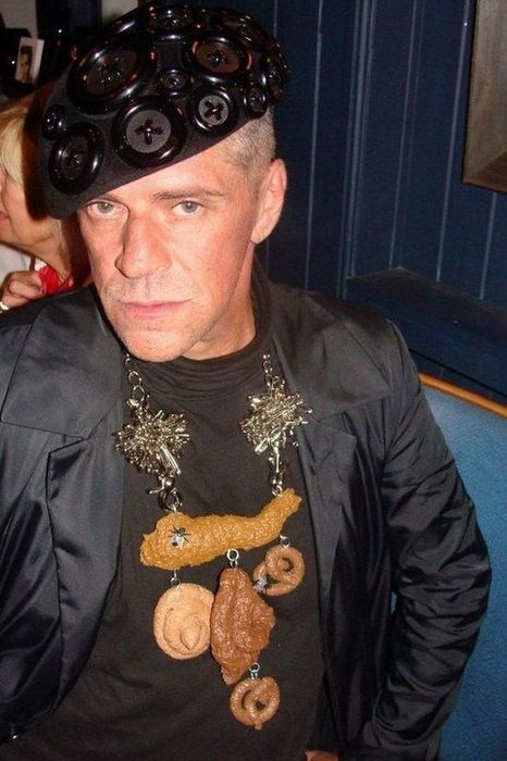 button necklaces hat poop poorly dressed