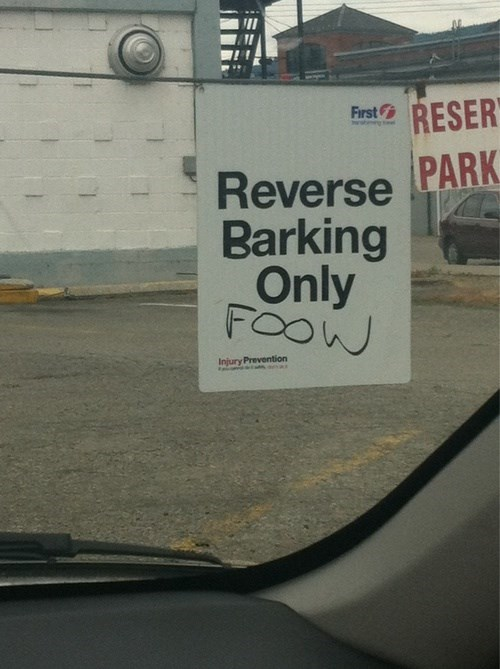 backwards,bark,dogs,parking,signs