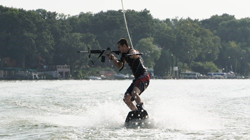 guns rifles waterskiing