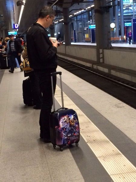 transformers,poorly dressed,platform,suitcase