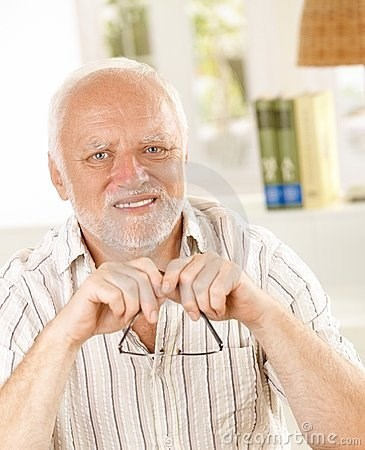 stock photo of Hide the Pain Harold holding his glasses regretfully