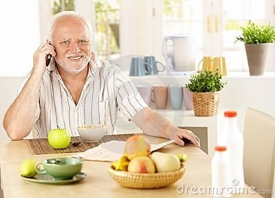 stock photo of Hide the Pain Harold answering the phone with a pained expression