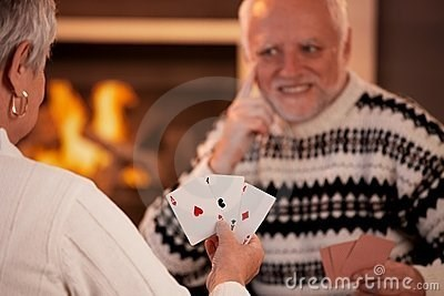 stock photo of Hide the Pain Harold grinding his teeth while playing cards