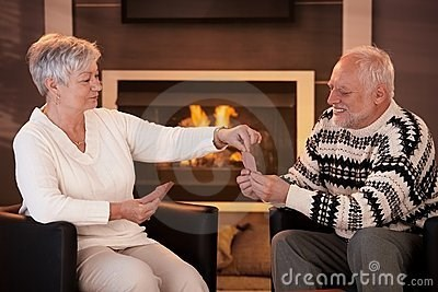 stock photo of Hide the Pain Harold looking tortured while playing cards