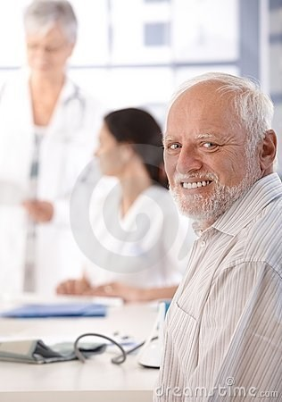 stock photo of Hide the Pain Harold forcing a smile at the doctor's office
