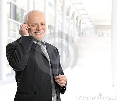 stock photo of Hide the Pain Harold smiling painfully while on the phone