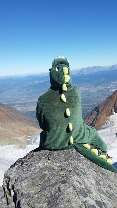 scenic,onesie,poorly dressed,mountains,dinosaurs