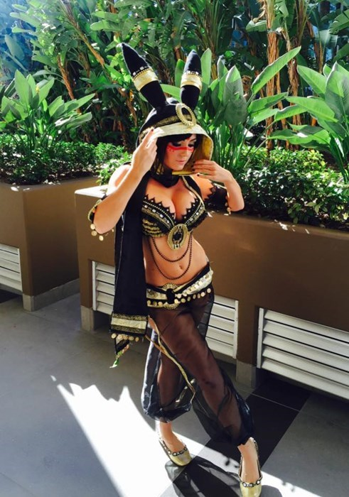 Photo of Jessica Nigri dressed as Umbreon by the indoor plants at Blizzcon.