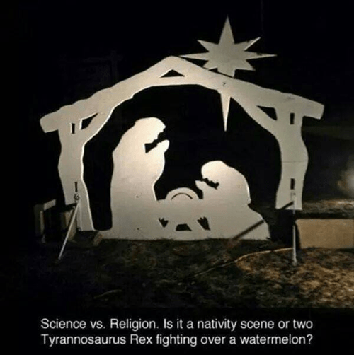 Font - Science vs. Religion. Is it a nativity scene or two Tyrannosaurus Rex fighting over a watermelon?
