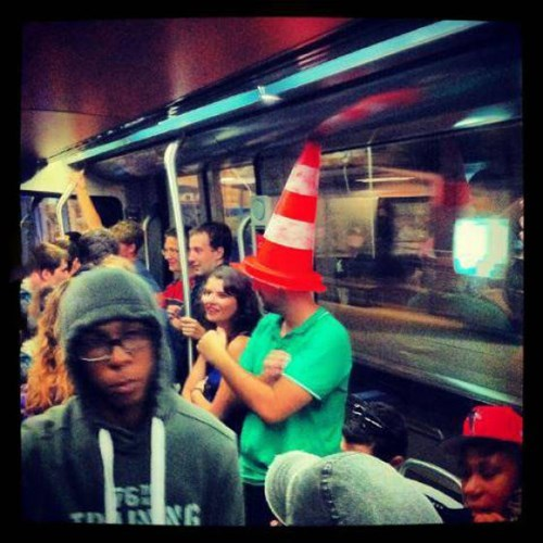 traffic cone,poorly dressed,Subway,hat