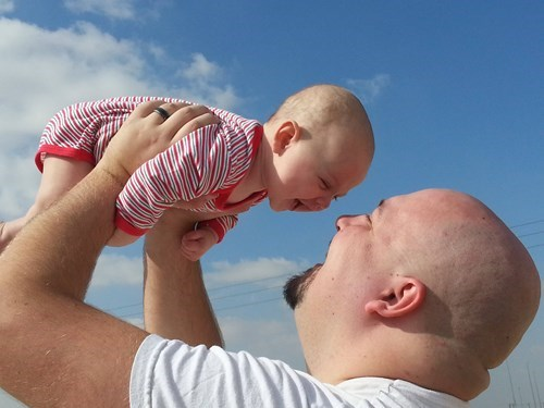 baby bald parenting dad happy