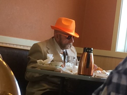 orange sunglasses poorly dressed fedora g rated