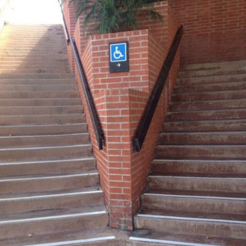 sign facepalm stairs disabled