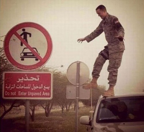 car surfing,signs,soldiers