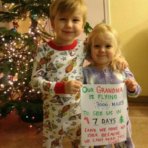 christmas sign reading kids grandma surprise parenting