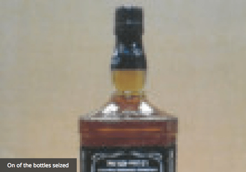 conman sells urine as whiskey