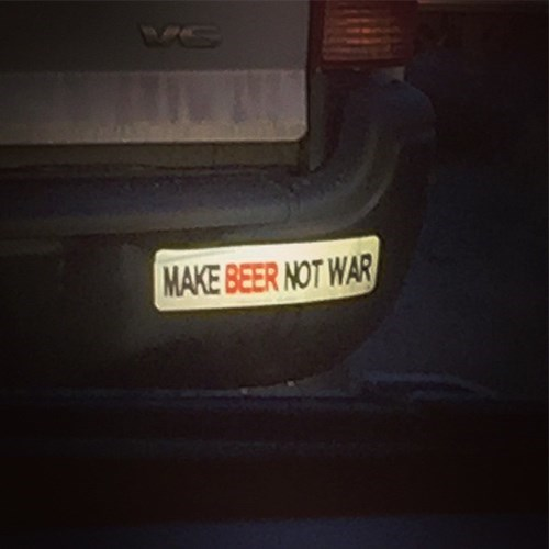 "bumper sticker says ""make beer not war"""