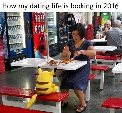 woman dines alone with a stuffed pikachu