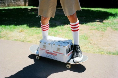 transporting beer on a skateboard