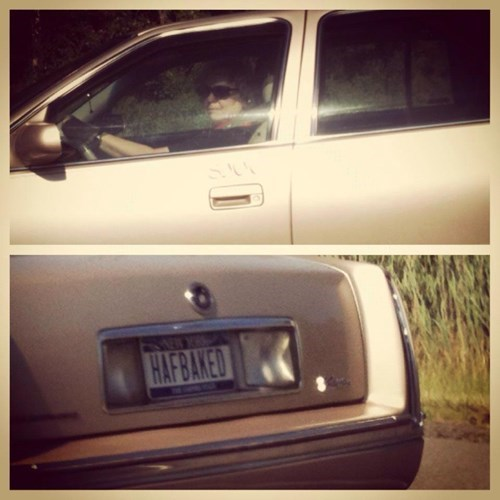 old lady has license plate saying half baked
