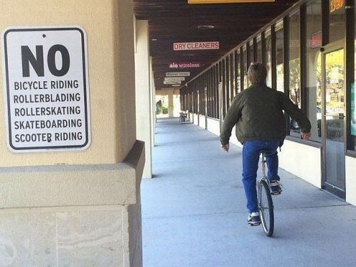 epic-win-pics-sign-rebel-unicycle