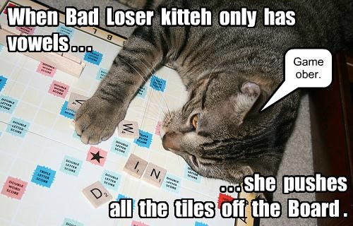 When Bad Loser kitteh only has vowels . . . . . . she pushes all the tiles off the Board . Game ober.