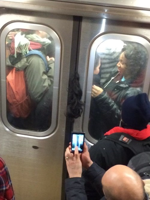 funny-fail-train-hair-door-new-york-l-train