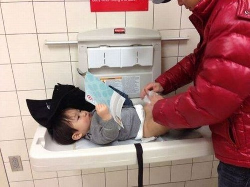 funny-parenting-pic-baby-changing-station-reading