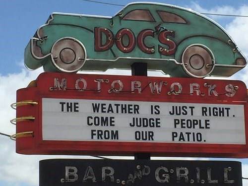 Motor vehicle - DOC'S MOTORW RKS THE WEATHER IS JUST RIGHT COME JUDGE PEOPLE OUR PATIO. FROM BAR. GR.I,L C