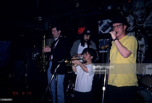 Tryion as Peter Dinklage plays trumpet