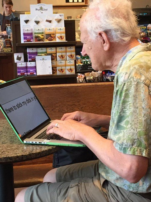 working computer old man writing expletives cafe