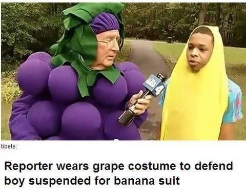 reporter wears grape costume for banana boy suspended
