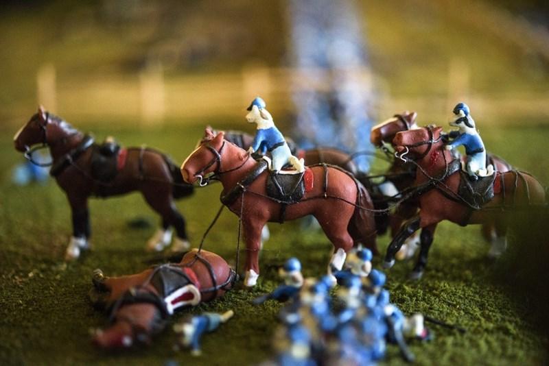 miniature cat soldiers in a battle