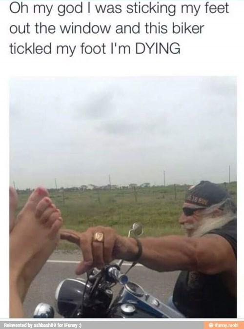 biker tickles foot on highway