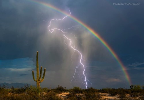 Photographer Greg McCown gets a killer picture of lightning over a rainbow.