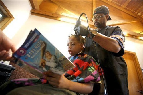 Kids can get a free haircut by reading to the barber in Iowa.