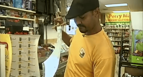 Store owner fights off sword thieves with his own bigger sword.