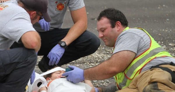 Good Guy of the Day: Firefighter Shows 'Happy Feet' To Young Crash Victim To Calm Him