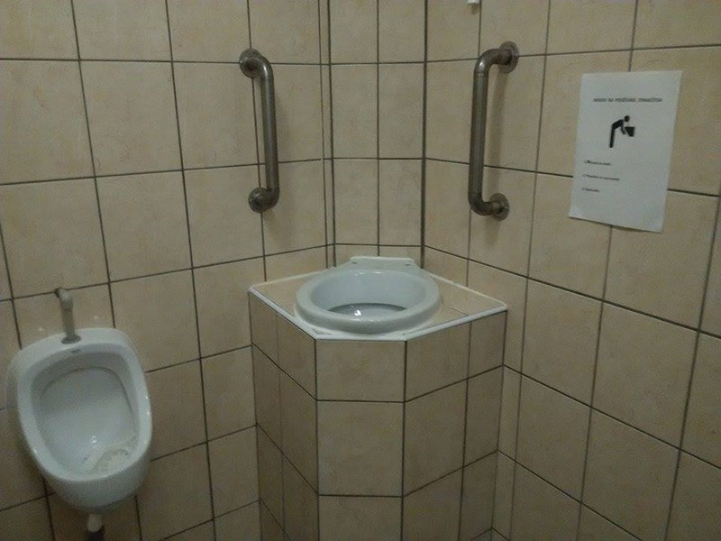 bar with specifically built toilet for puking in