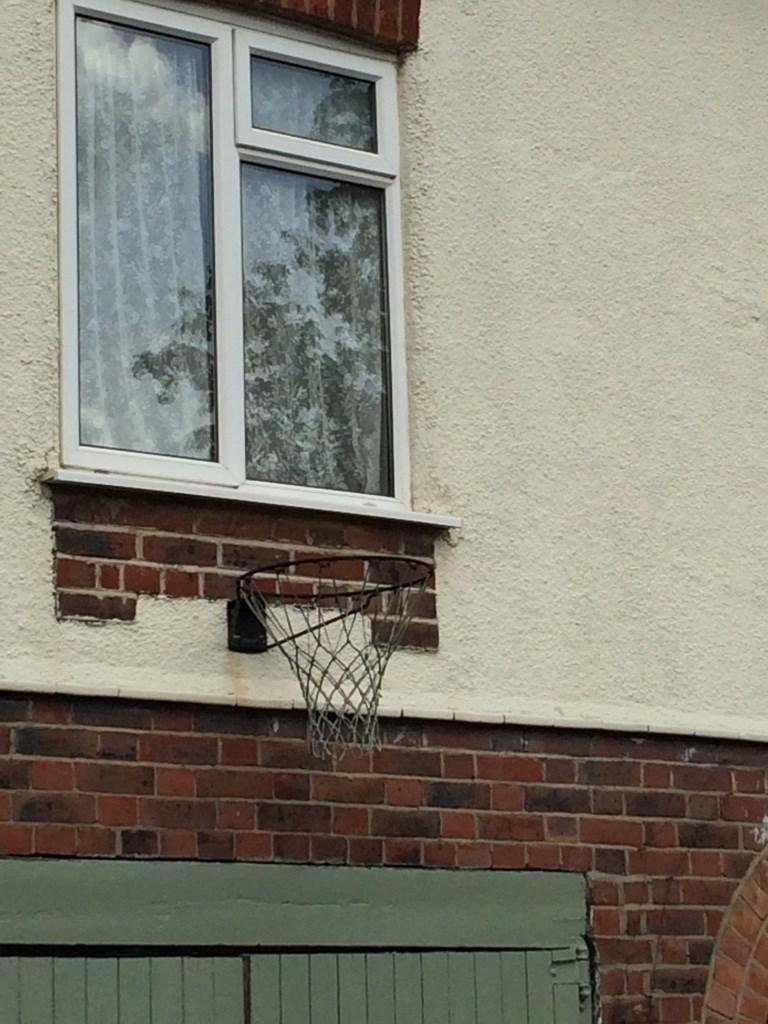 design fail of a basketball net installed under a glass window