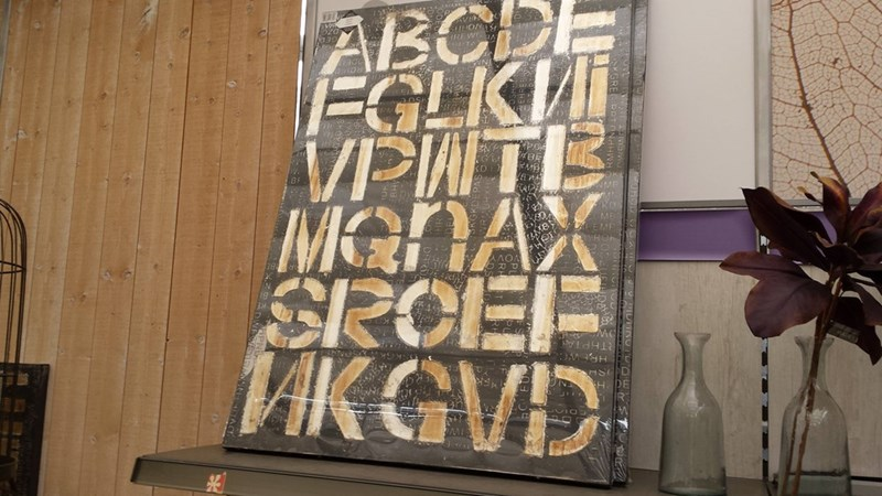 design fail of a decorative wood plank with random letters on it