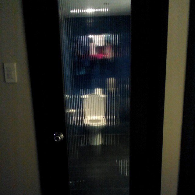 design fail of a restroom stall door that is mostly see through