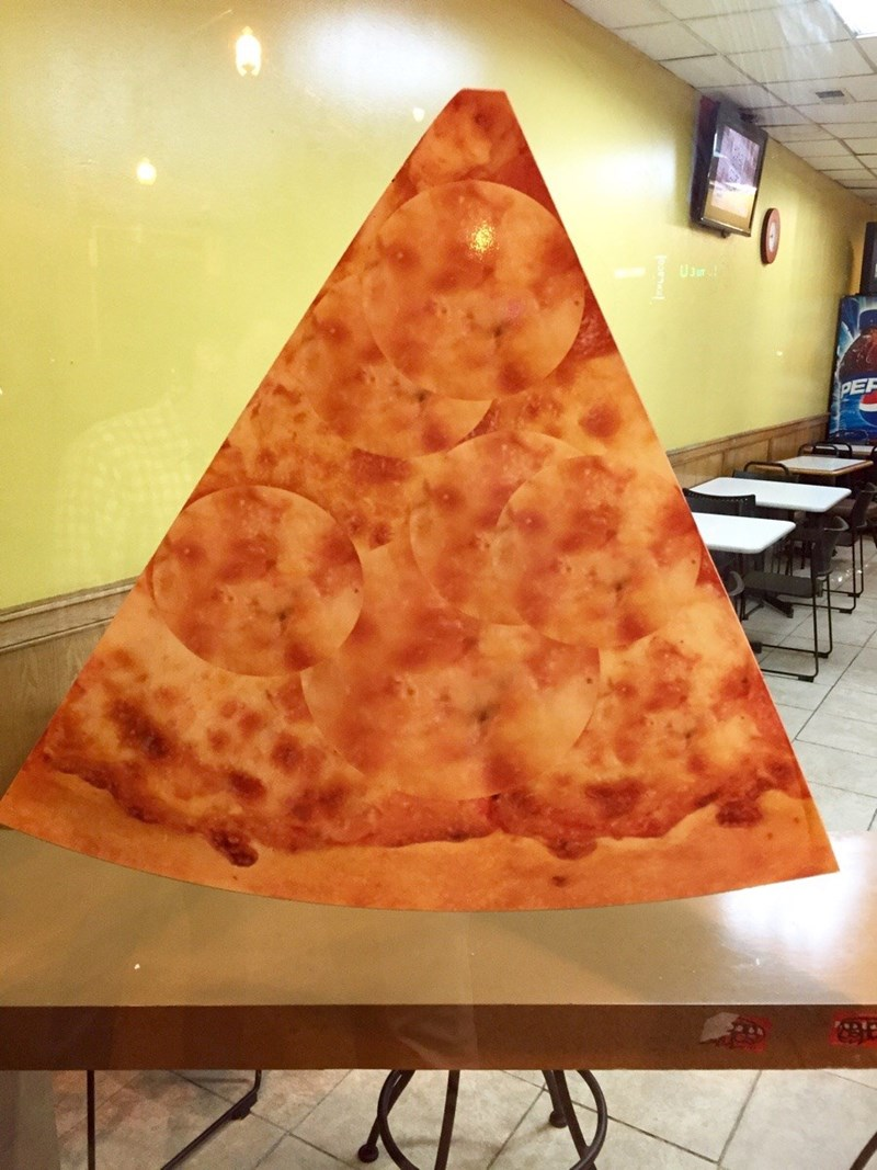 design fail of a pizza slice with the pepperonis badly photoshopped out