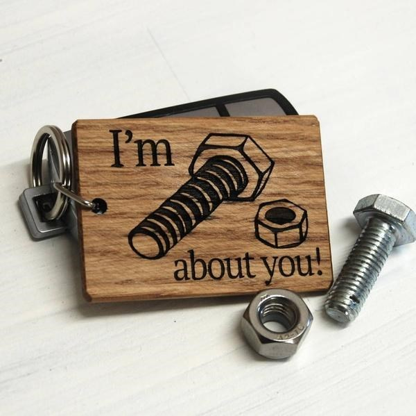 """design fail of a key chain that's meant to read """"i'm nuts about you"""""""