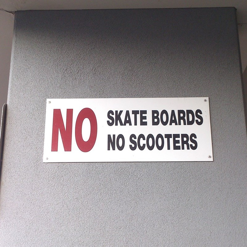 design fail of a sign prohibiting skate board but allowing scooters